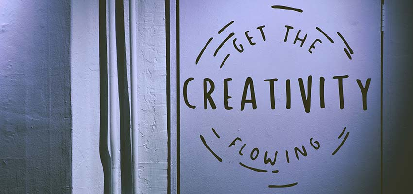 "A poster that reads, ""Get the Creativity Flowing""."